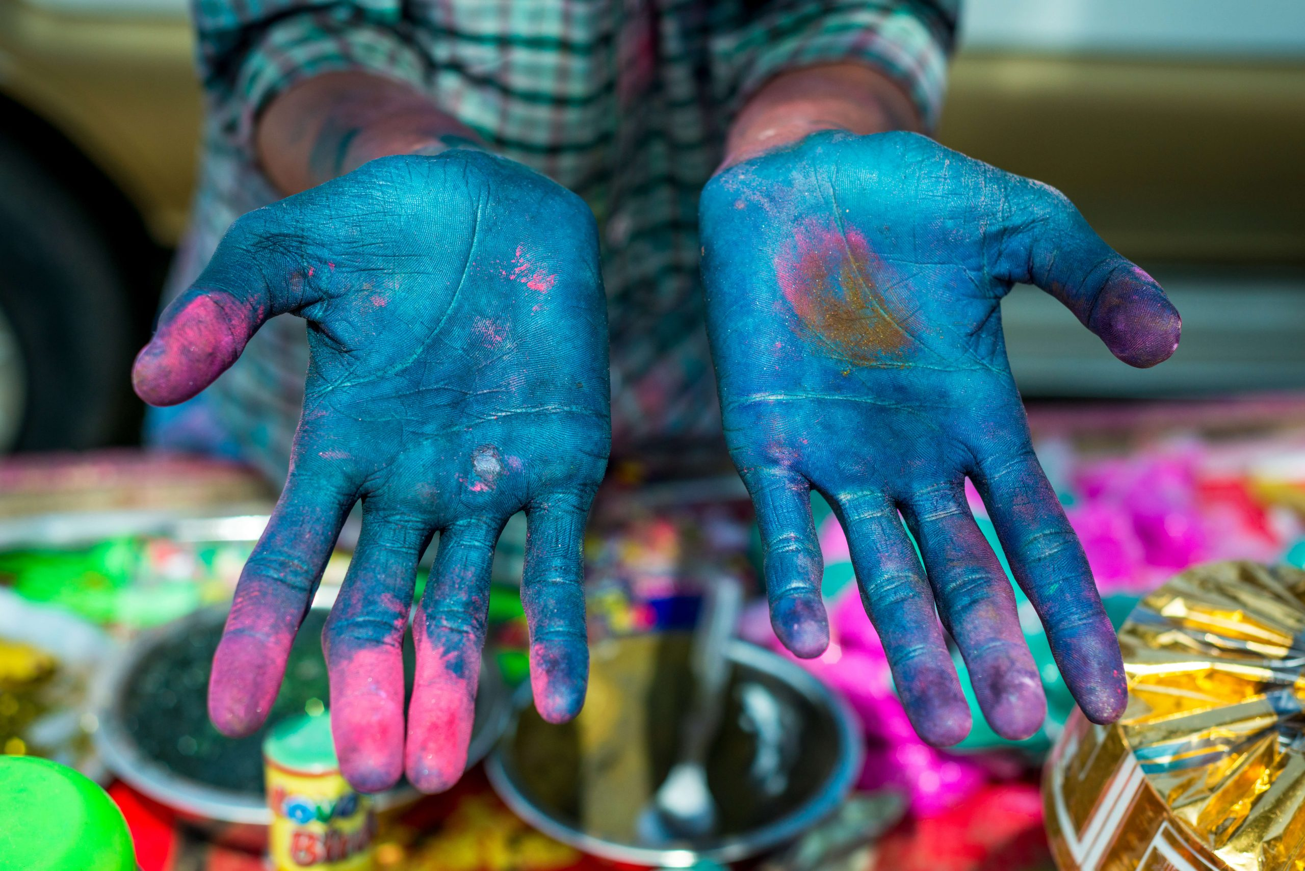 Colourful hands during Holi festival in Rajasthan, India