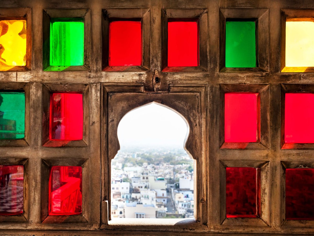 Coloured glass window at City Palace in Udaipur, Rajasthan